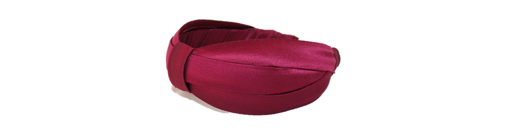 This is a beautiful headband that is lightweight, comfortable, and because the silk is lined with crinoline it gives your hair 'height'. An elegant headband for the season. You can find it right here:  http://www.reneerivera.com/couture/2-inch-silk-headband-garnet?category=Headbands