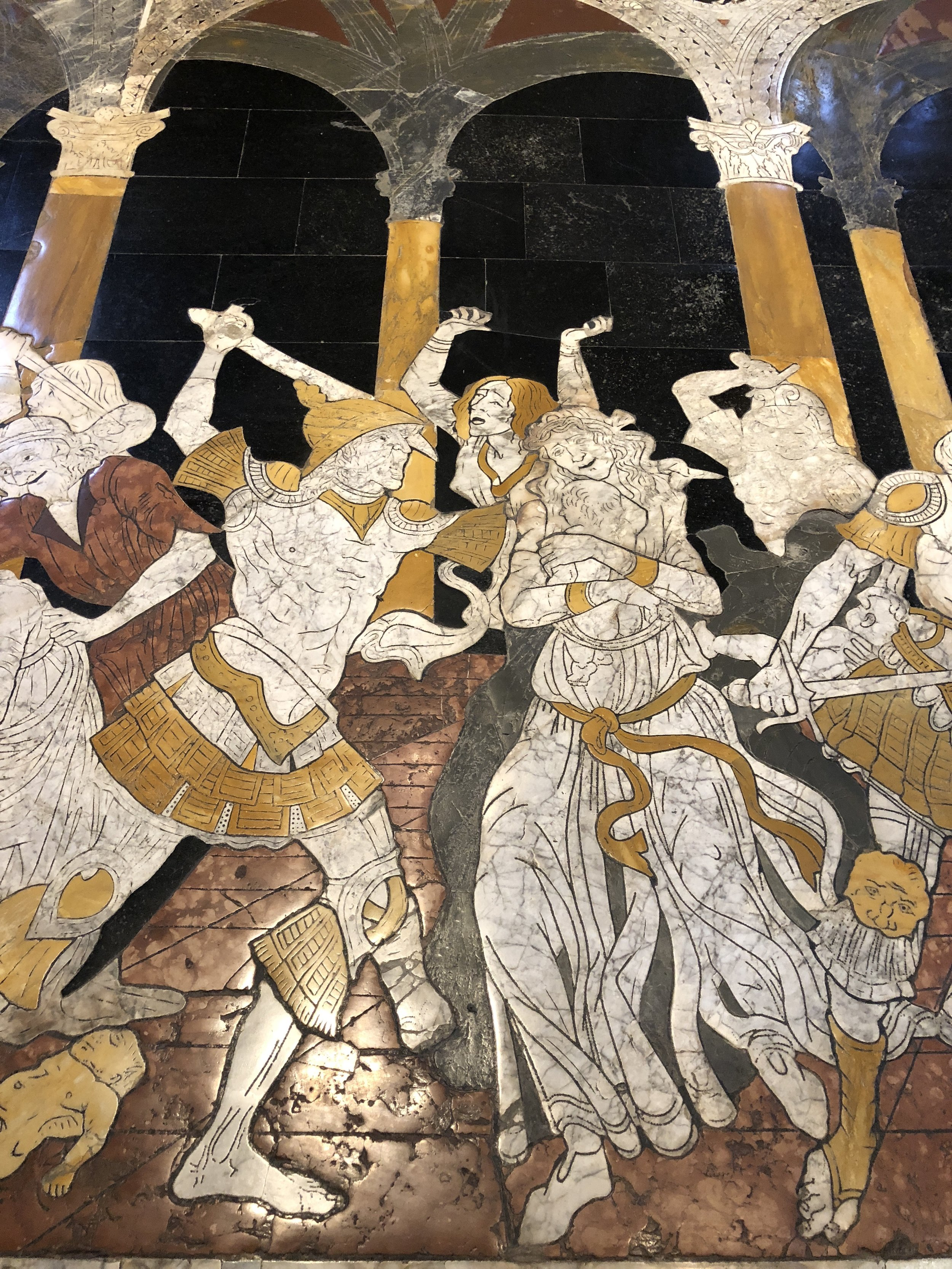 Detail of one of the marble mosaics on the floor of the Siena Cathedral. This is called the  Massacre of the Innocents,  which is based on the passage in Matthew 2 where King Herod tries to kill the baby Jesus by murdering all the male children in Bethlehem under the age of two.