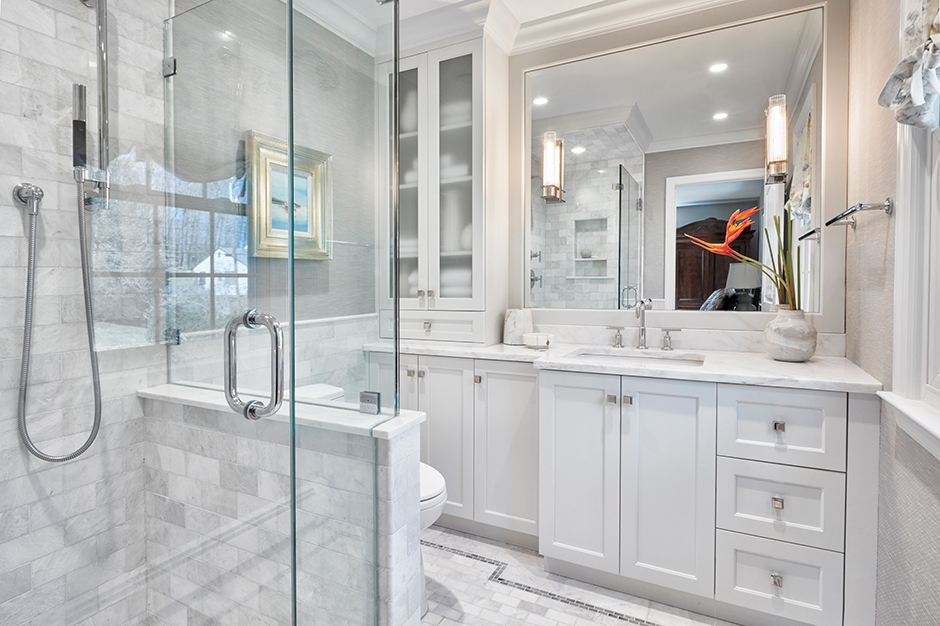Before designer Claudia Giselle of New York City-based Claudia Giselle Design stepped in, this glamorous and open bathroom was dark, dated and dysfunctional.