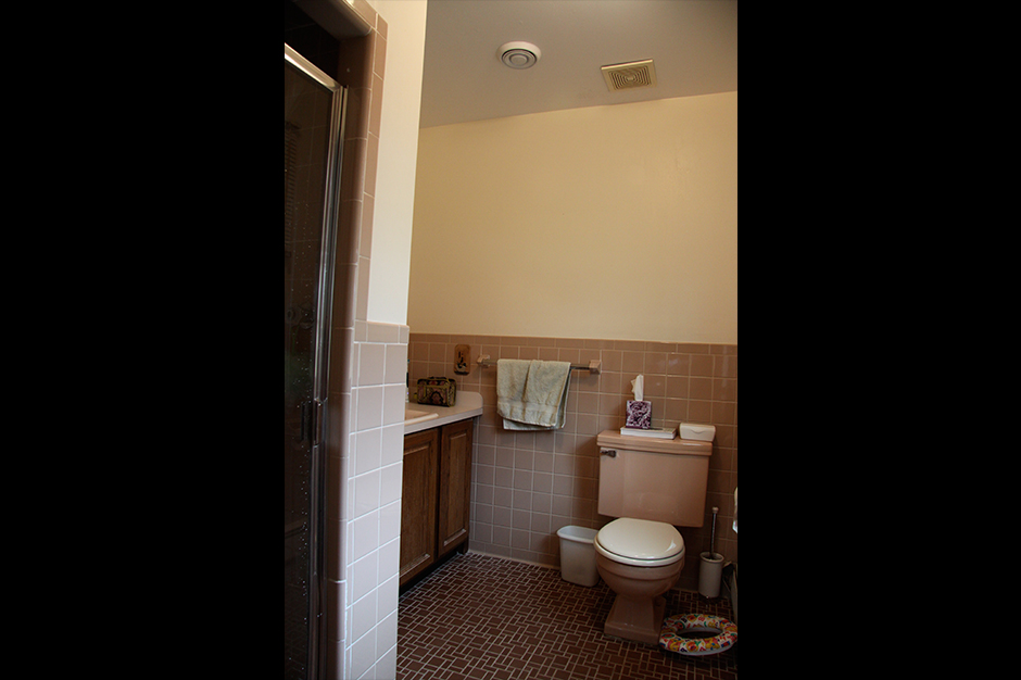The toilet was the first item in sight upon entering the bathroom. Giselle proposed swapping the location of that and the vanity for a more appealing entrance and more storage space.