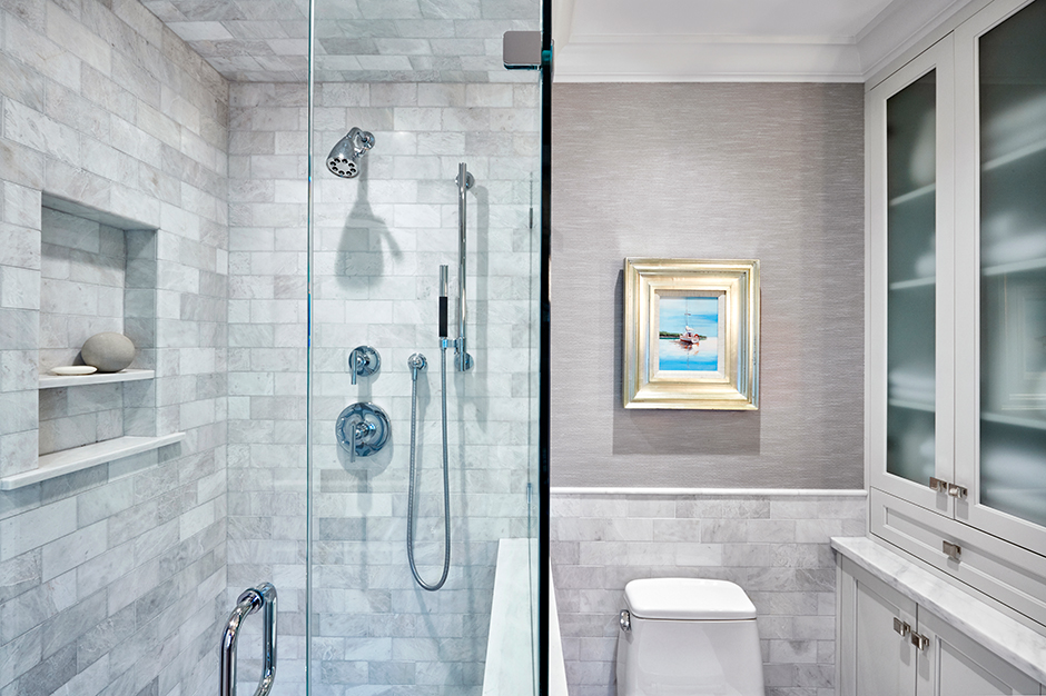 Marble countertops – as well as marble tiles on the floor, walls and ceiling – give the bath a luxurious and welcoming tone. The racessed niche in the shower adds function, depth and style.