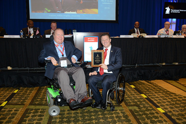 """On behalf of the Gateway Chapter, President Brown accepted the """"Most Outstanding Chapter"""" award for 2016 (there are 34 Chapters of Paralyzed Veterans of America)."""
