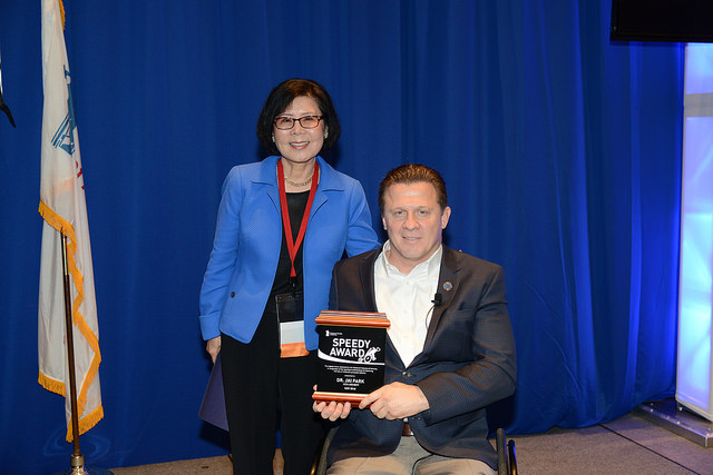 """Dr. Jai Park receiving the non-member Speedy Award for 2016. This award is given """"in recognition of significant contributions to improving the lives of America's paralyzed veterans."""""""