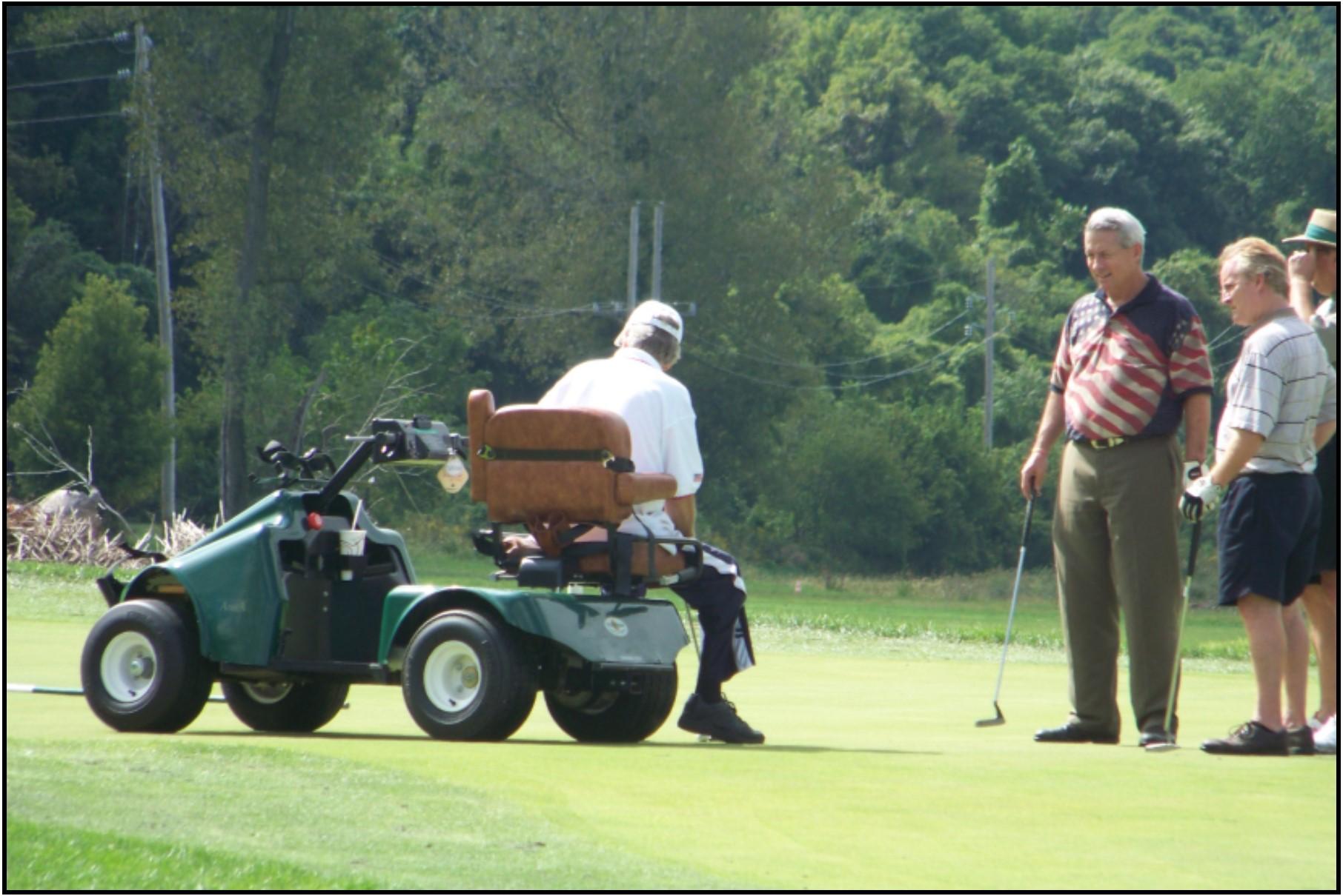 Accessible golf cart - Dennis putts.jpg