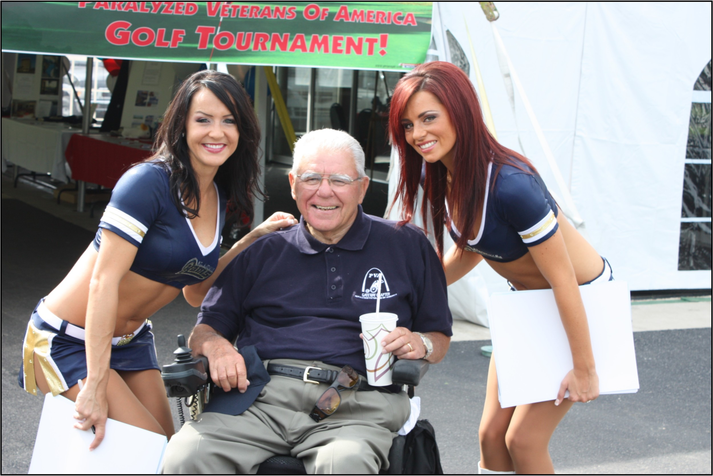 Bob with the Rams Cheerleaders.JPG