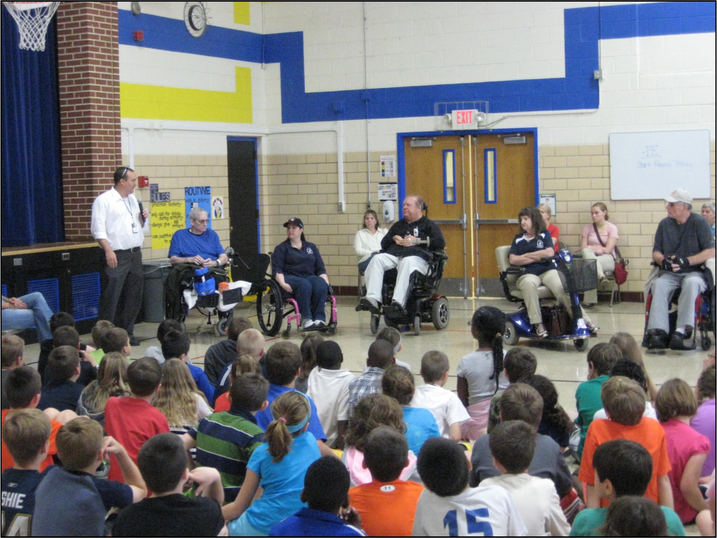 Matt tells the children about wheelchair games.jpg