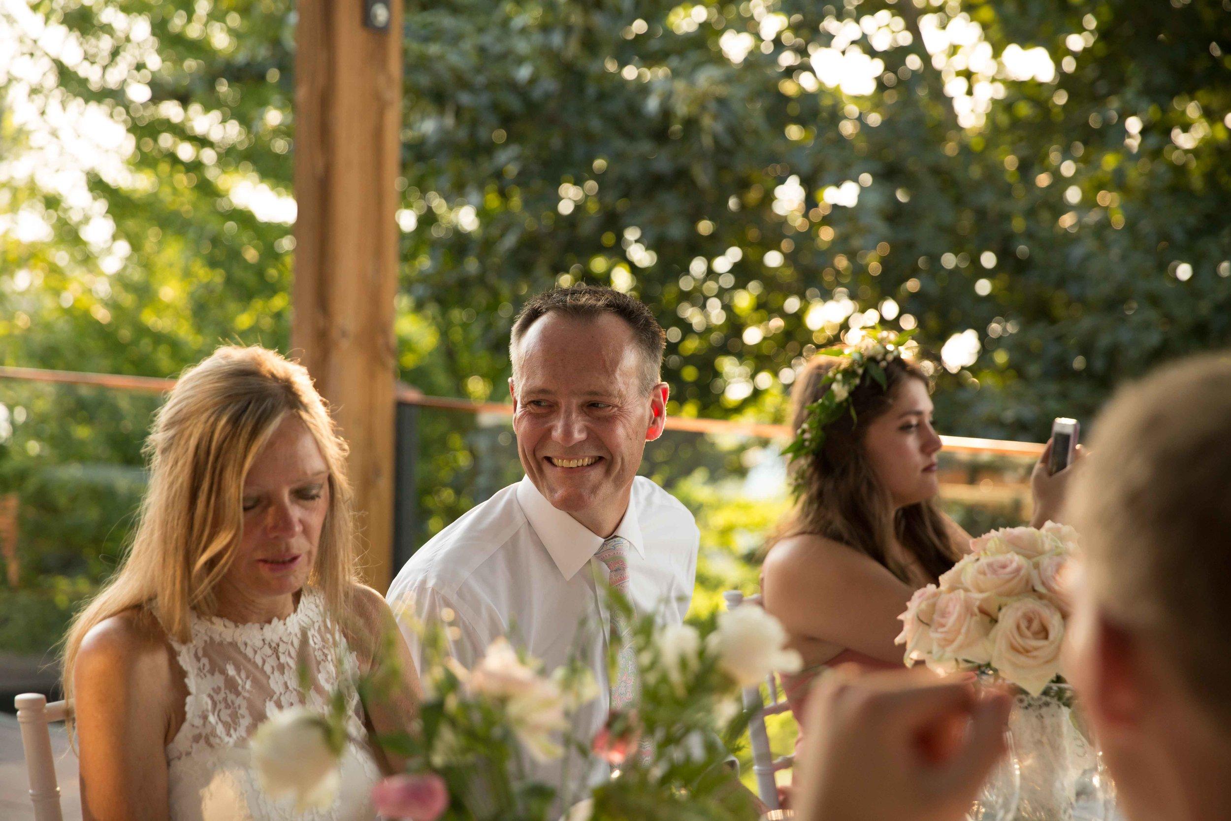 Groom smile at bride