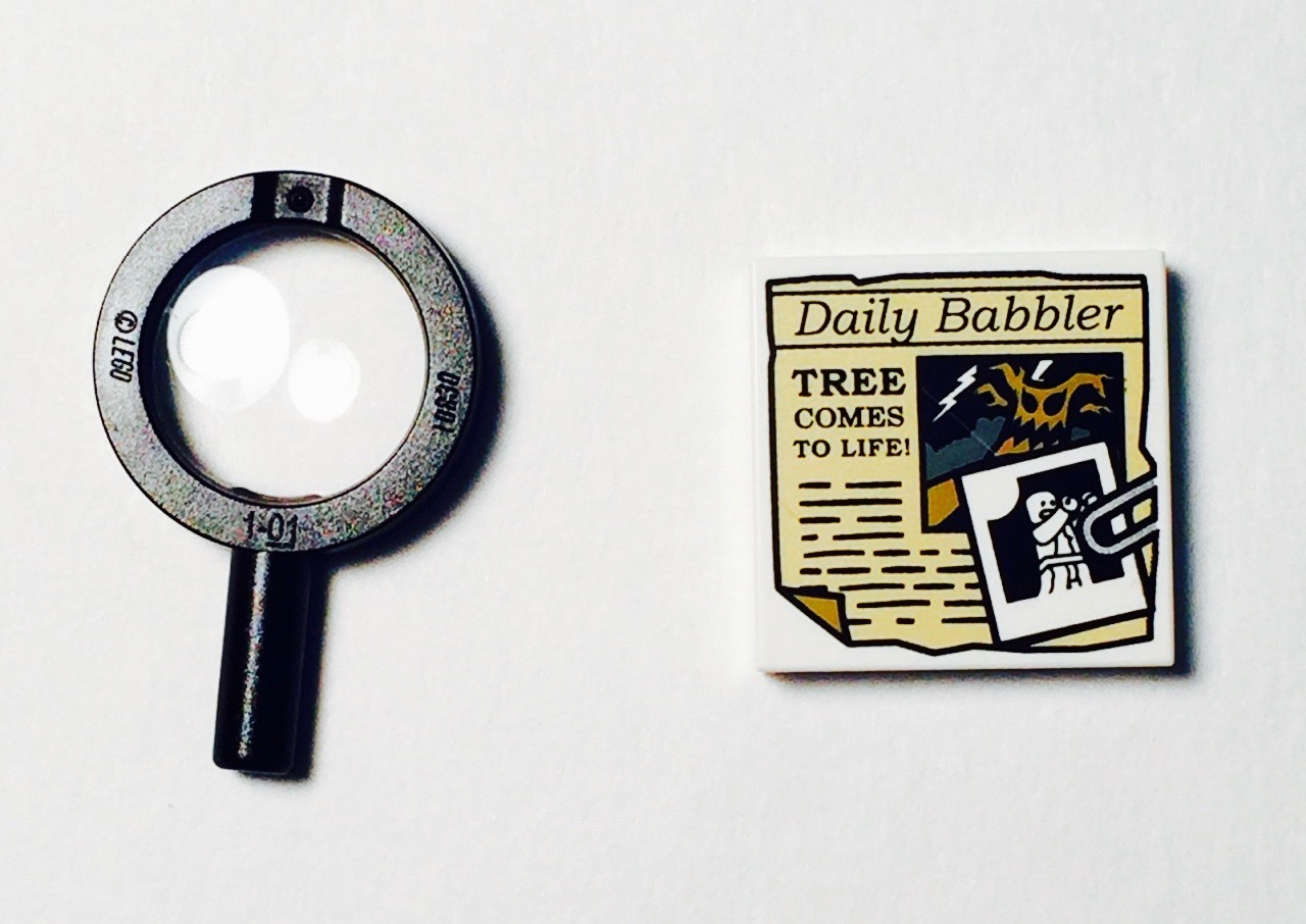 Minifigure accessories include working magnifying glass and 2x2 tile with Daily Babbler print