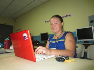 Amber rocks a nagua (the indigenous dress) while updating the blog!