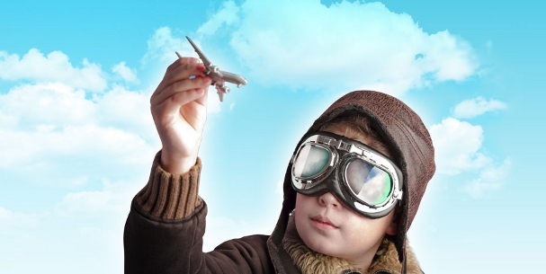 boy_with_plane_607x305.jpg