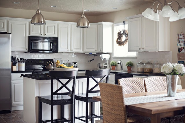 We loved helping take a bland kitchen and make it a classic black and white kitchen with a huge island work space with seating. The perfect place for a young family. . . . #kitchenrenovation #cabinetmaker #kitchendesign #kitchendecor #homerenovation #customcabinets