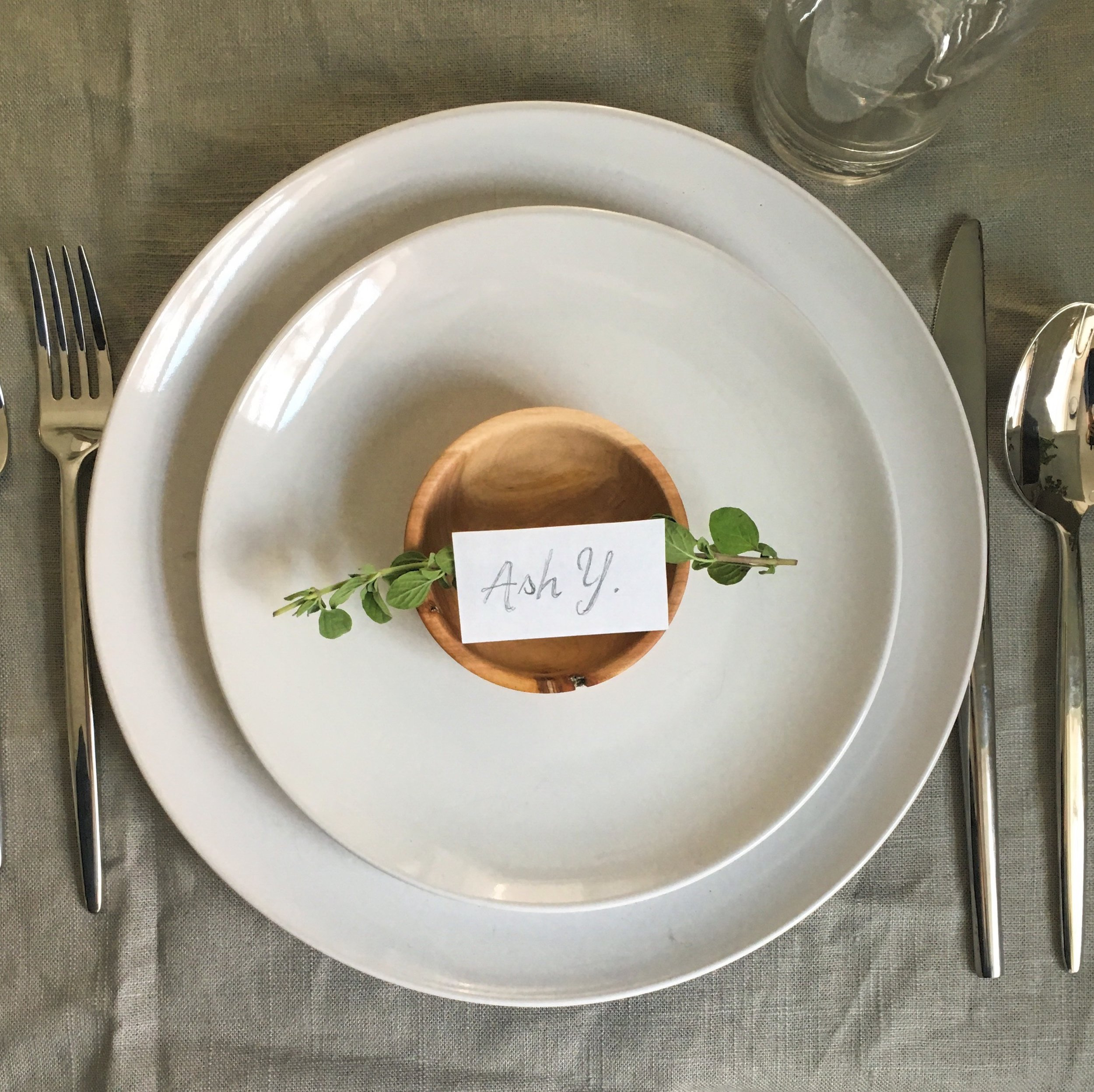 Simple thanksgiving place setting using handmade wood pinch pot and herbs