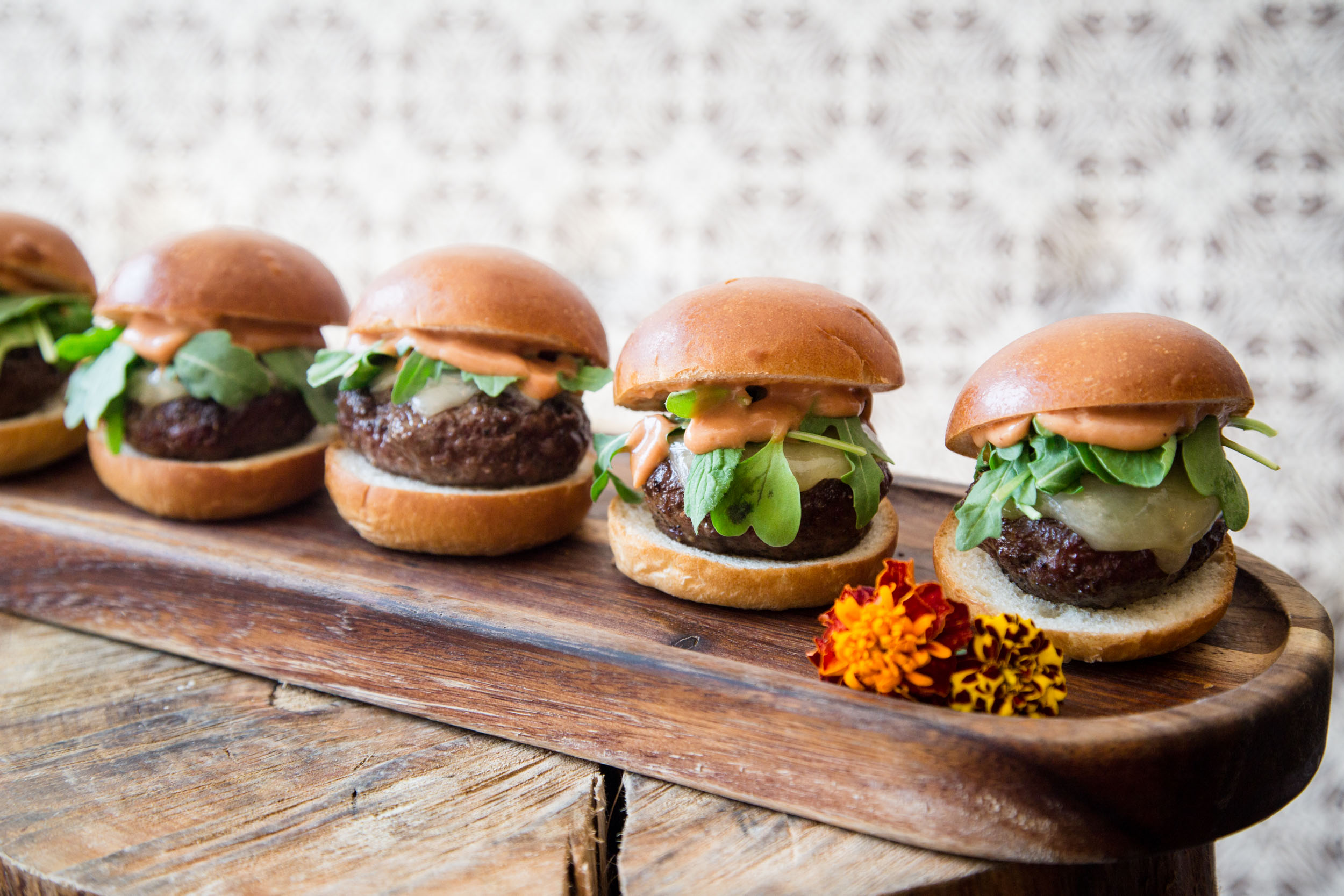Grass-Fed Beef Slider with Cabot Cheddar, Arugula, and Special Sauce on Potato Bun