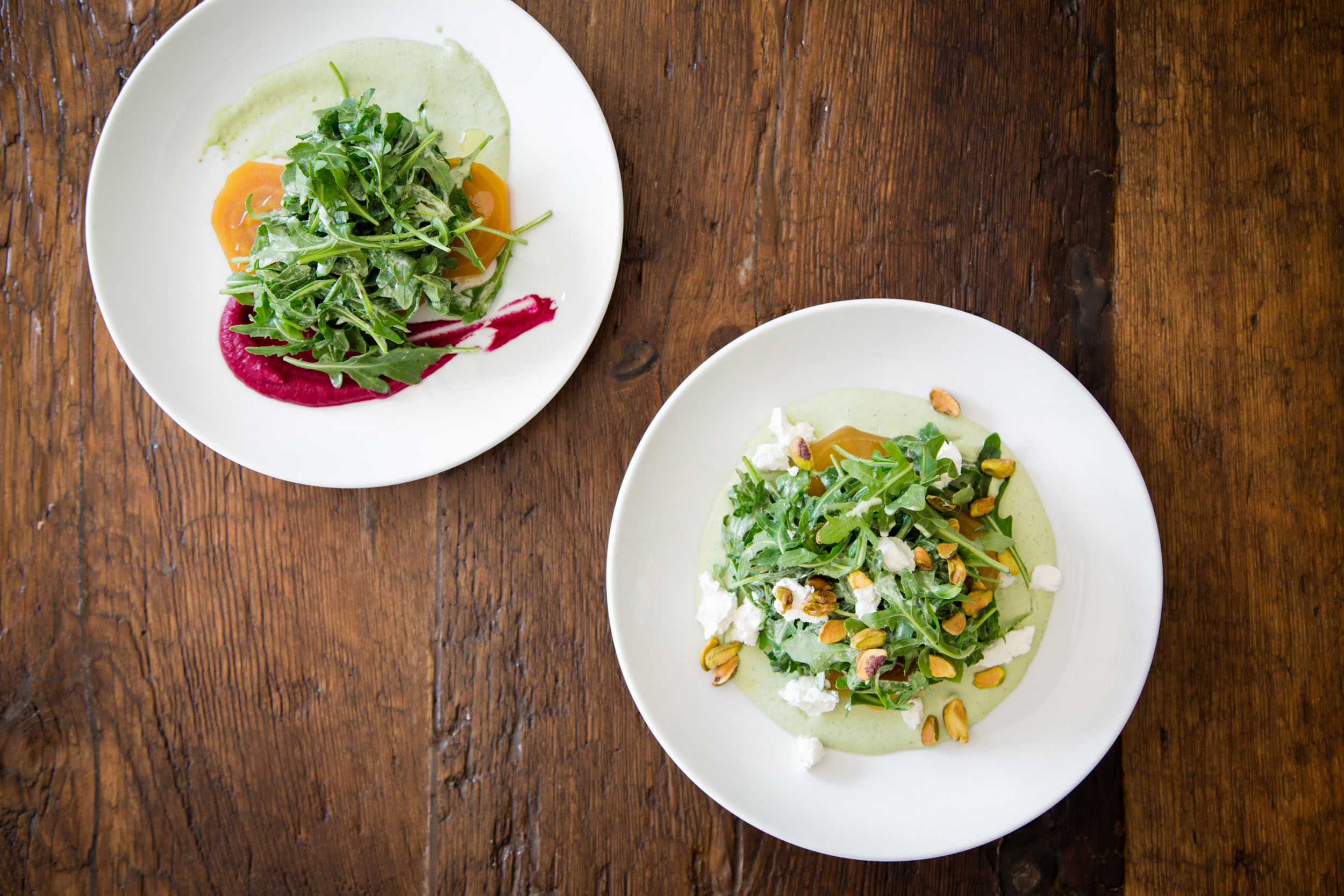 Roasted Golden Beets with Goat Cheese, Hearty Greens, Green Goddess Dressing, and Crushed Pistachios