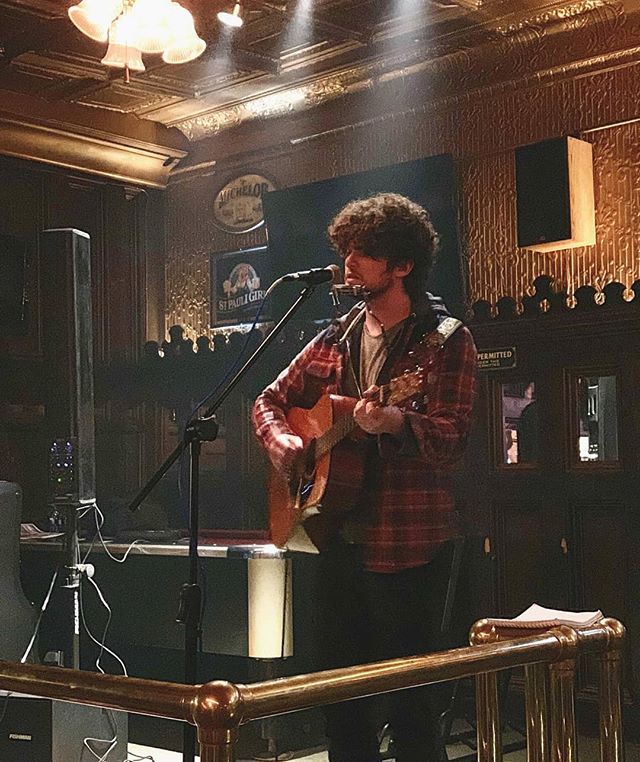Probably lost three days off my life singing at a Pennsylvania bar that allows indoor smoking. Time for tea and cough drops. Photo by @unclearmind . . . . . #folkmusic #guitar #harmonica #singersongwriter #livemusic #pennsylvania #mechanicsburgpa #acousticguitar #folk #originalartist #musician #alecjames #travel #gig #bar #pinklung #harrisburgpa #music