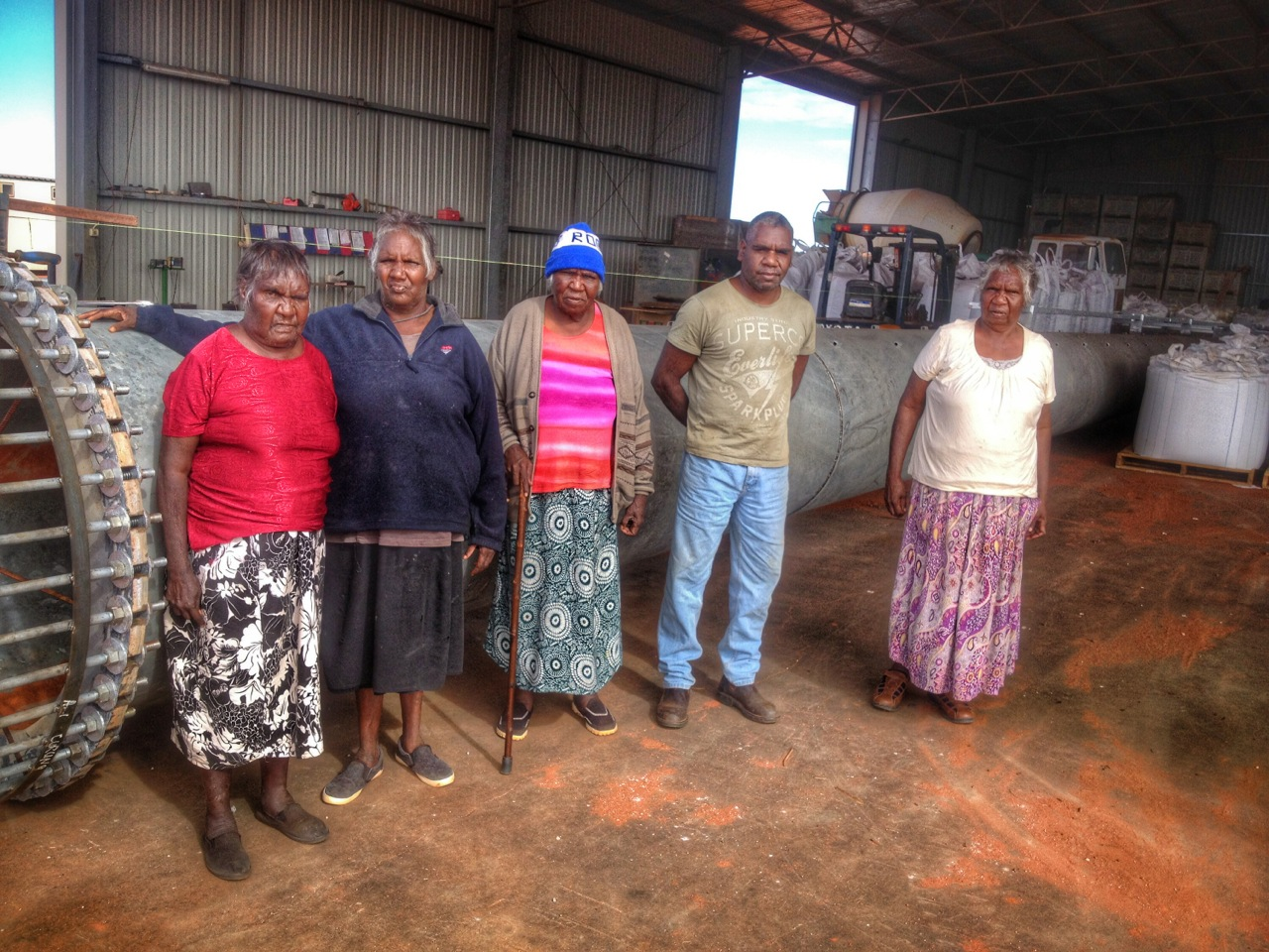 Pictured: Some of the Ali Curung locals gathering at the large steel Cross that they have a vision to see raised up in their community.