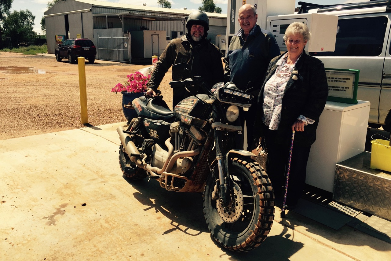 Pictured: Dave and Sue from the town of Quilpie donated a tank of fuel for the Crossing Australia Harley.