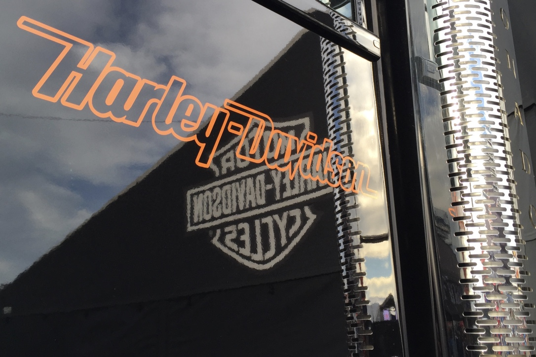 Pictured: The glossy black and chrome of one of Harley Davidson's truck fleet.