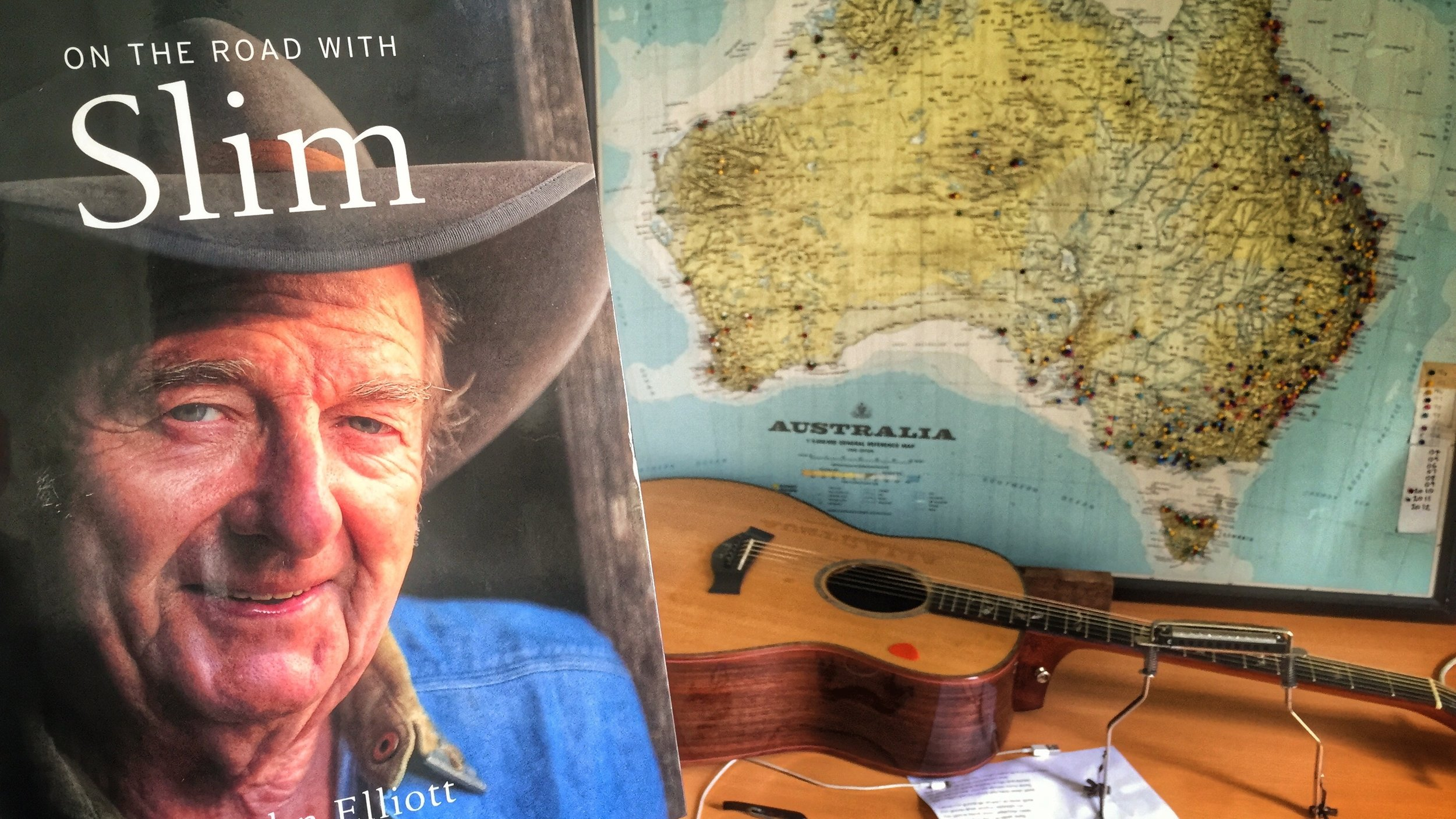 Pictured: The legendary Slim Dusty and a map of his beloved country.