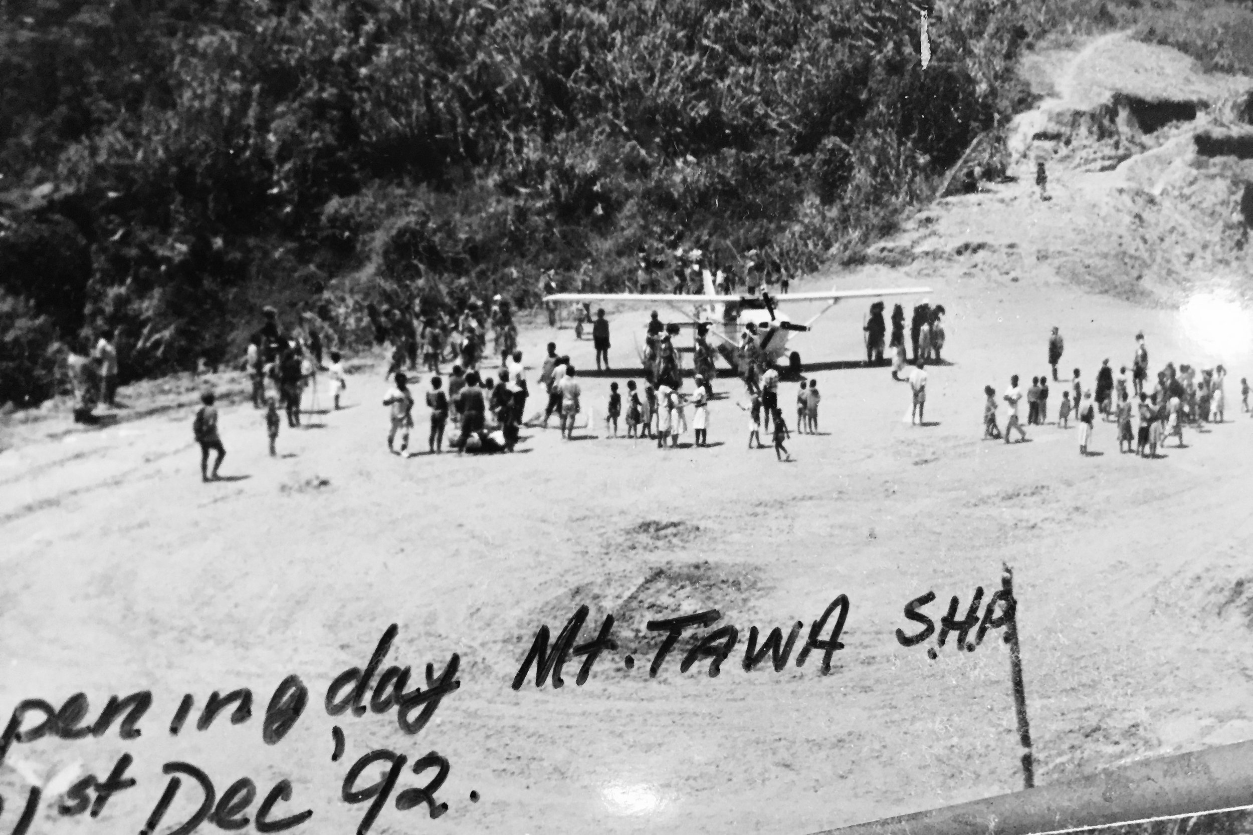 Pictured: The official opening of the Mt Tawa airstrip in the Southern Highlands of PNG. With a successful landing of a Cessna 206 to celebrate with the remote tribal group.