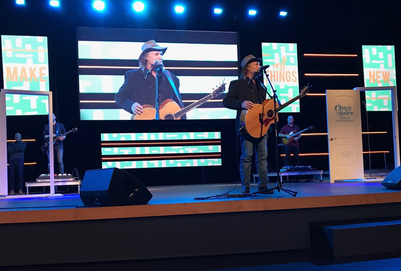 Pictured: Steve sharing songs and encouraging people to mission at Wave Church.