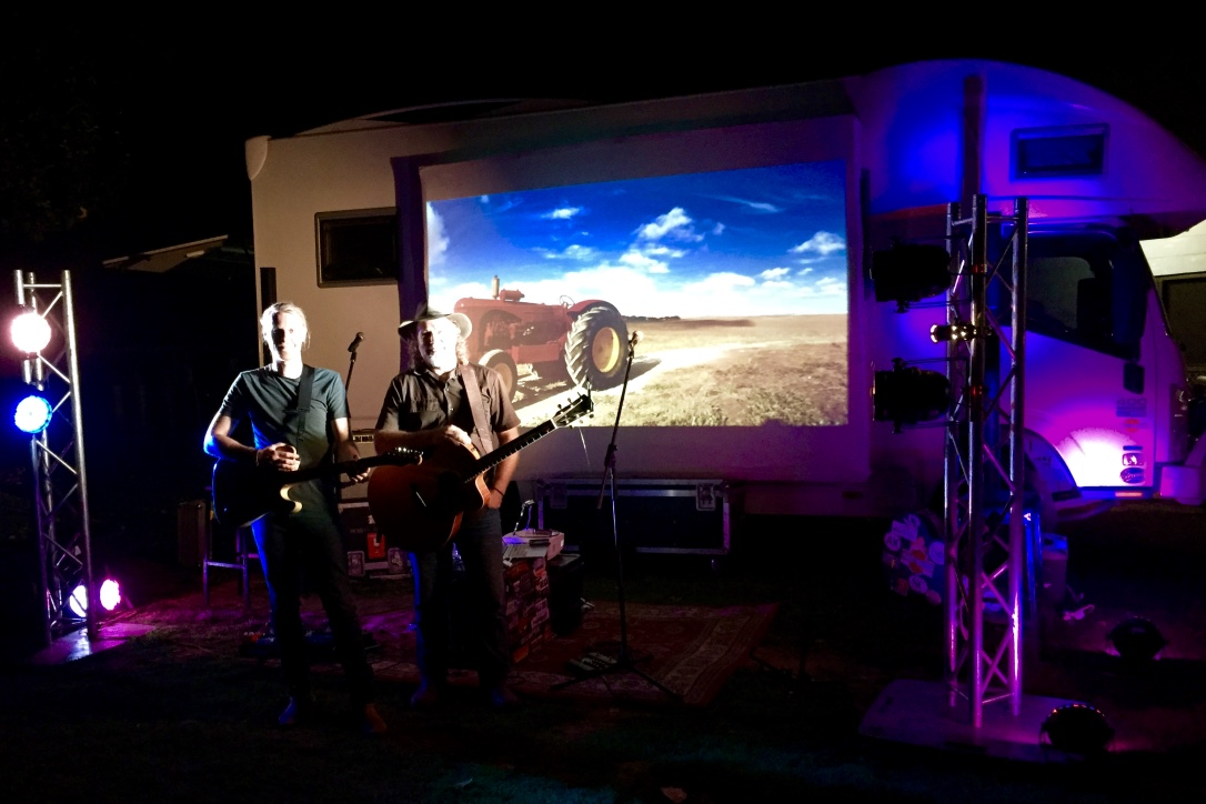 Pictured: Trentan and Steve with the outdoor stage set up in the Clermont Caravan Park last Friday night.