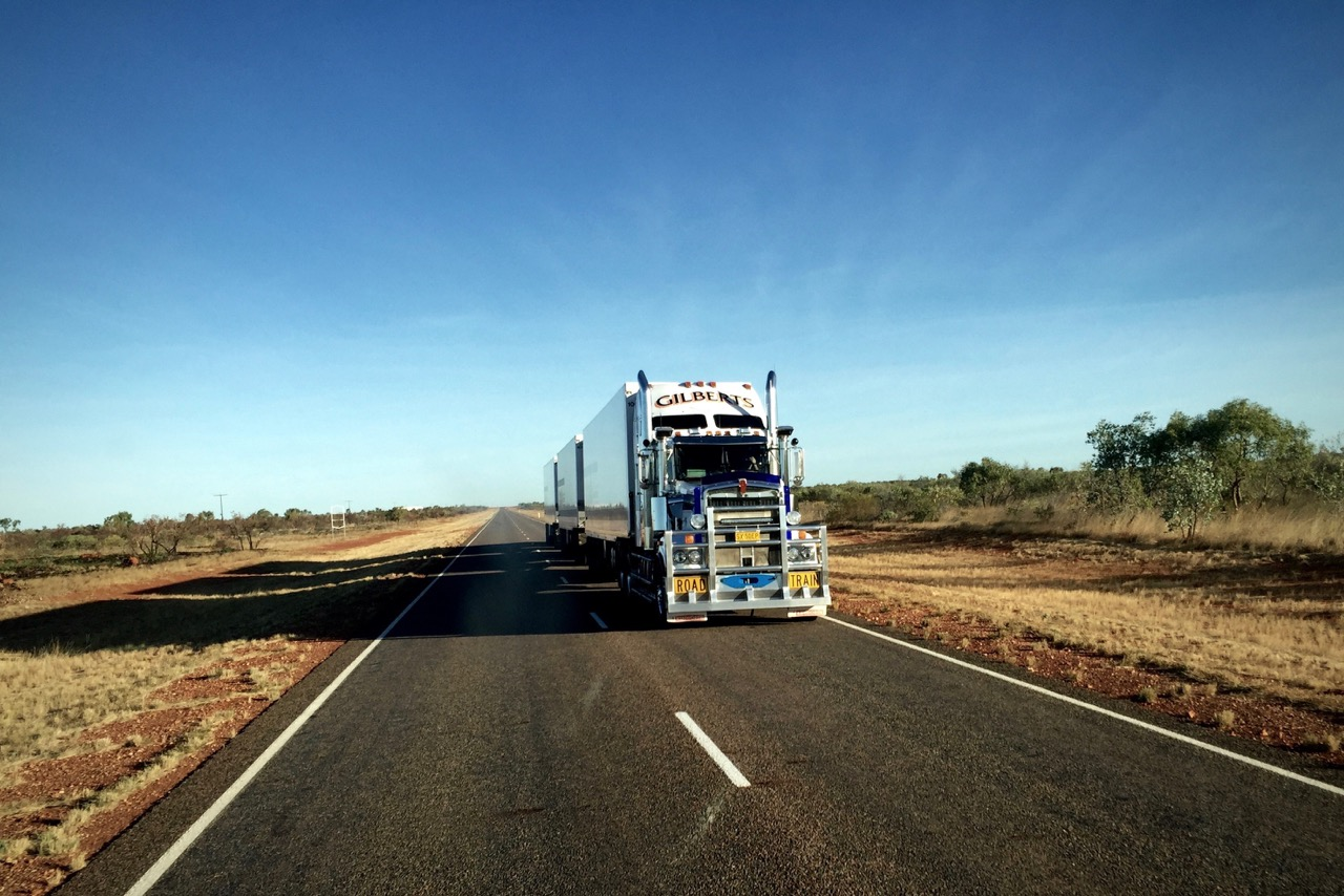 Pictured: A long nose Kenworth triple trailer Road Train heading south on Australia's only inland north/south road towards Alice Springs, NTl
