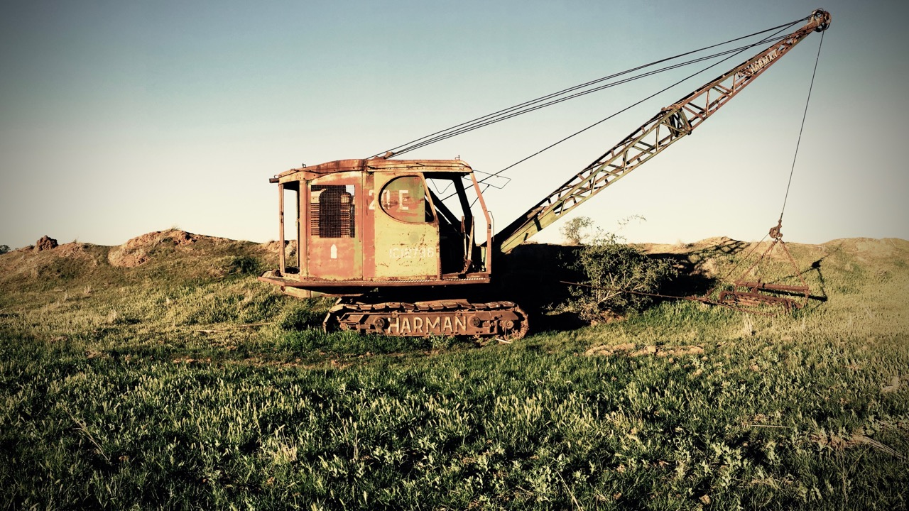 Pictured: A vintage Harman crane standing dormant in a paddock somewhere on the Hay Plains near Rankins Springs, NSW.