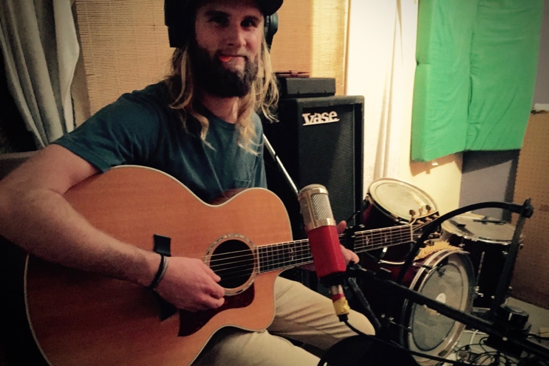 Pictured: Jordan Grace laying down a final acoustic track for Children of the Western World.
