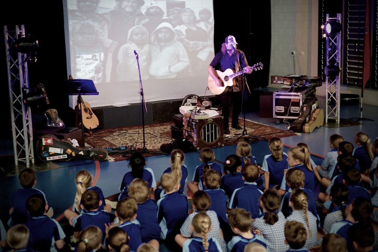 Pictured: Steve sharing some songs with students from Cannonvale State School before the songwriting and music workshop last week.