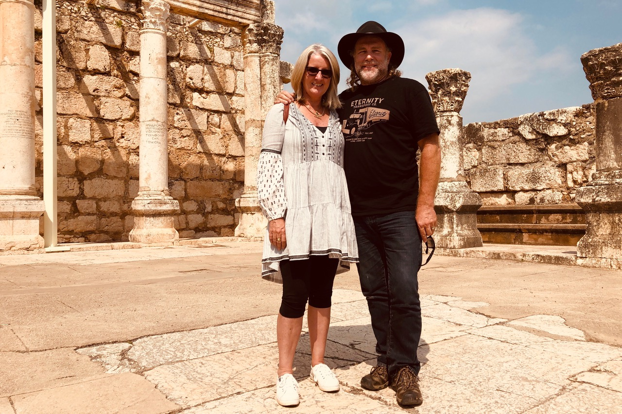 Pictured: Steve and Kerrie at the ancient ruins of the synagogue in Capernaum, Israel.