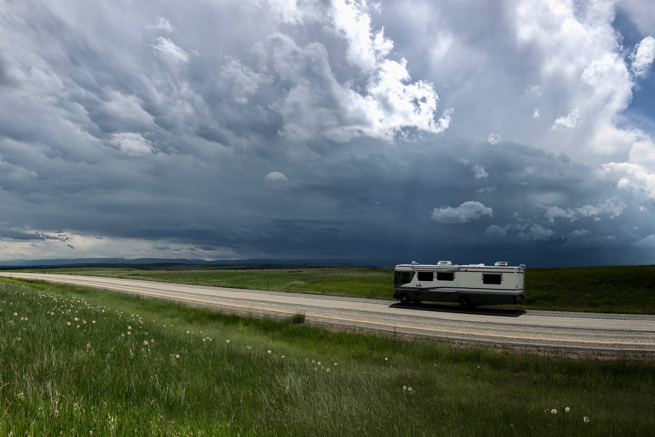Pictured: Somewhere in South Dakota a few weeks back. Distant storms and road travel in North America.