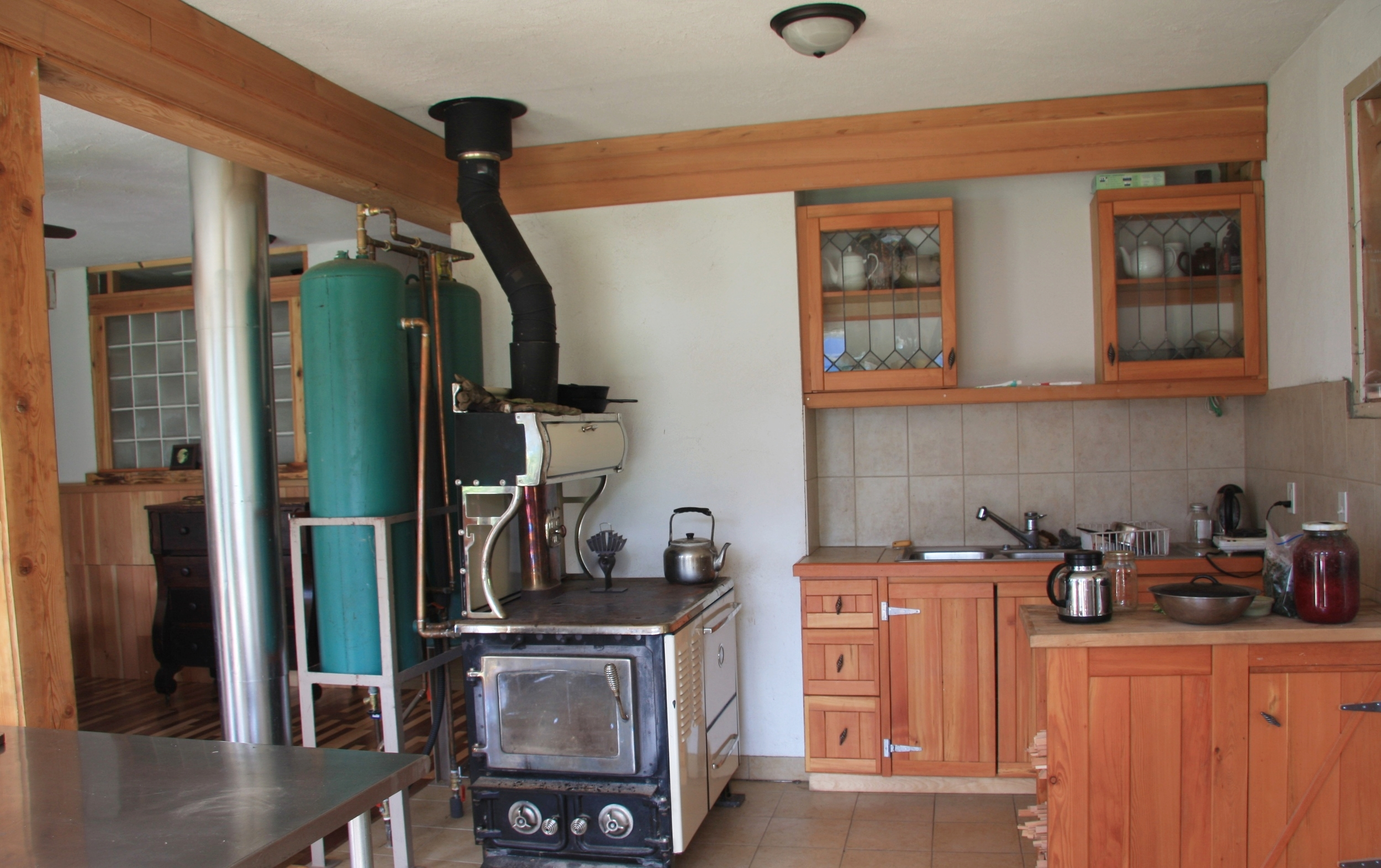 Grandma's kitchen features a flame view wood burning stove.