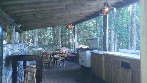 The outdoor kitchen is surrounded by prestine forest.