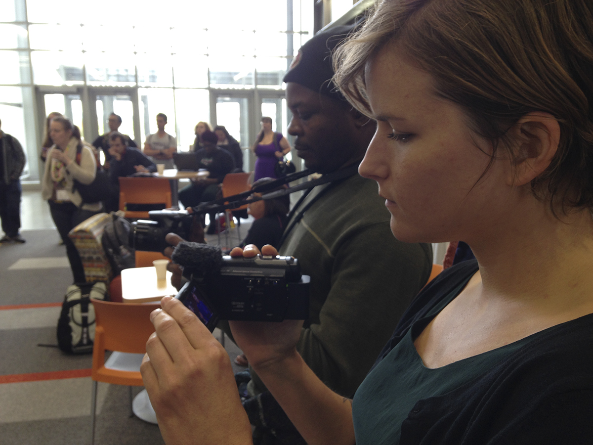 Video trainees at CoLang 2016, practice filming a cultural performance of Tlinglit singers at the University of Alaska, Fairbanks.