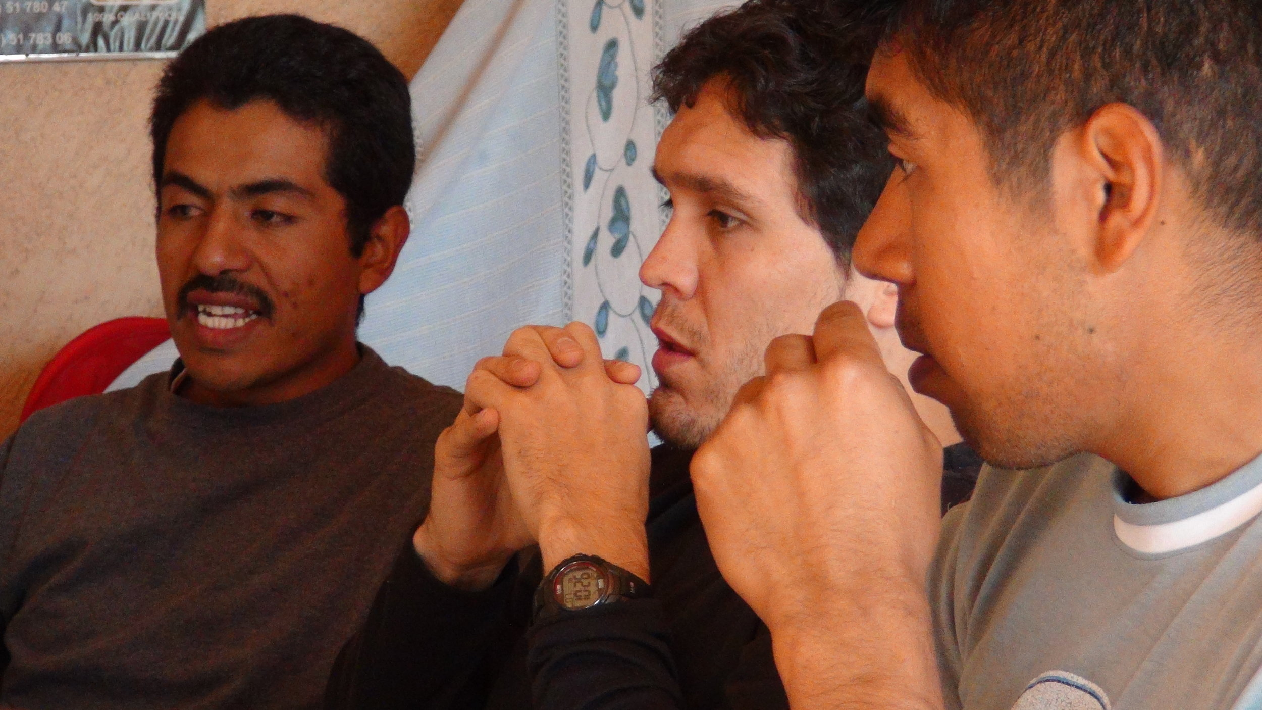 Daniel Quintanilla (center) mentors visual literacy with Mixe Community Self Documentation team members.