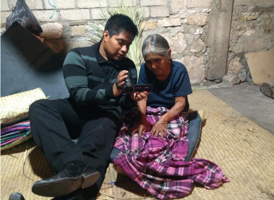 Ricardo Jiménez Jiménez, from San Pedro Jaltepetongo, Cuicatlán, Oaxaca, shows his video footage to a community participant.