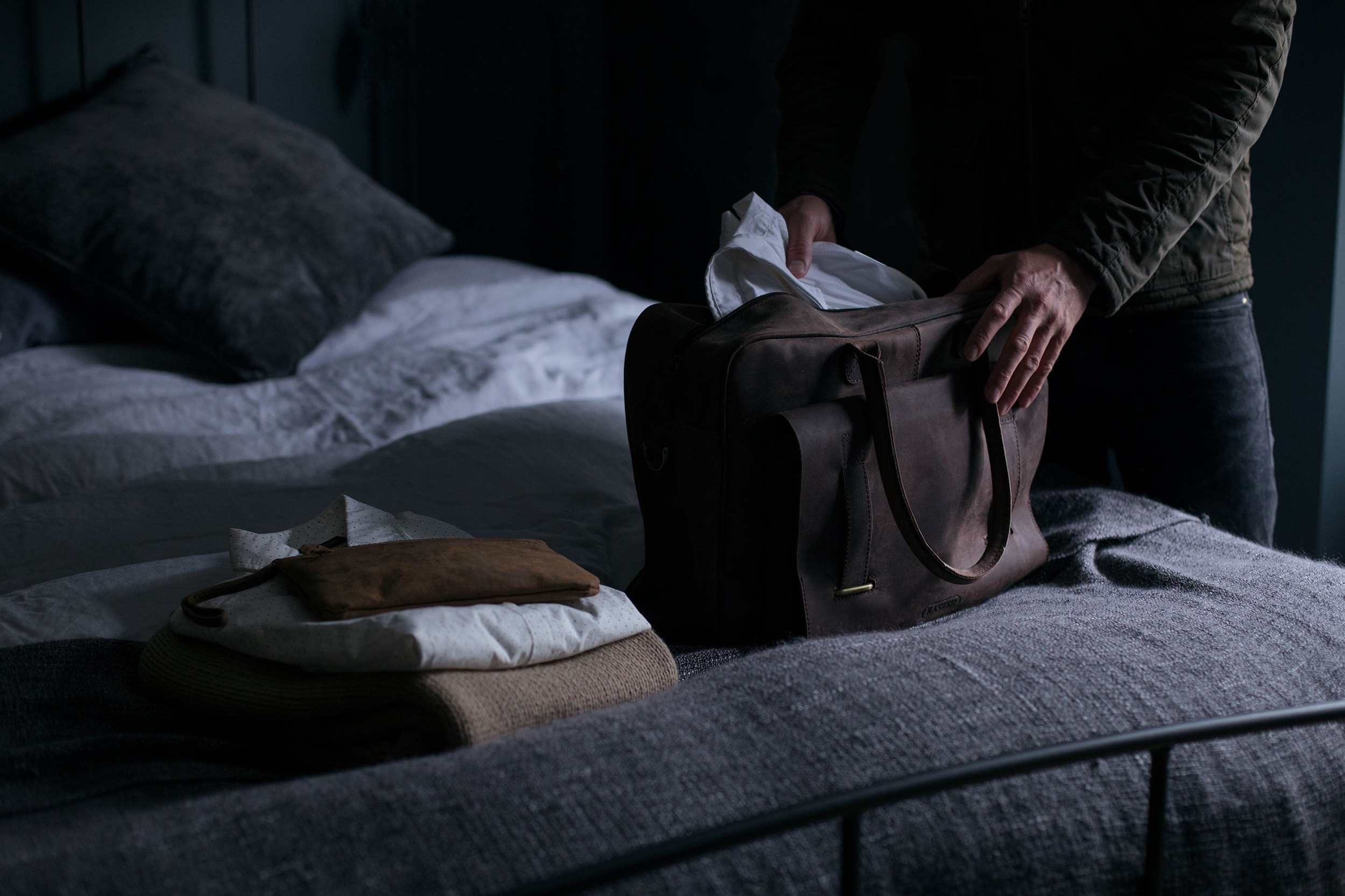 Man packing Leather bag