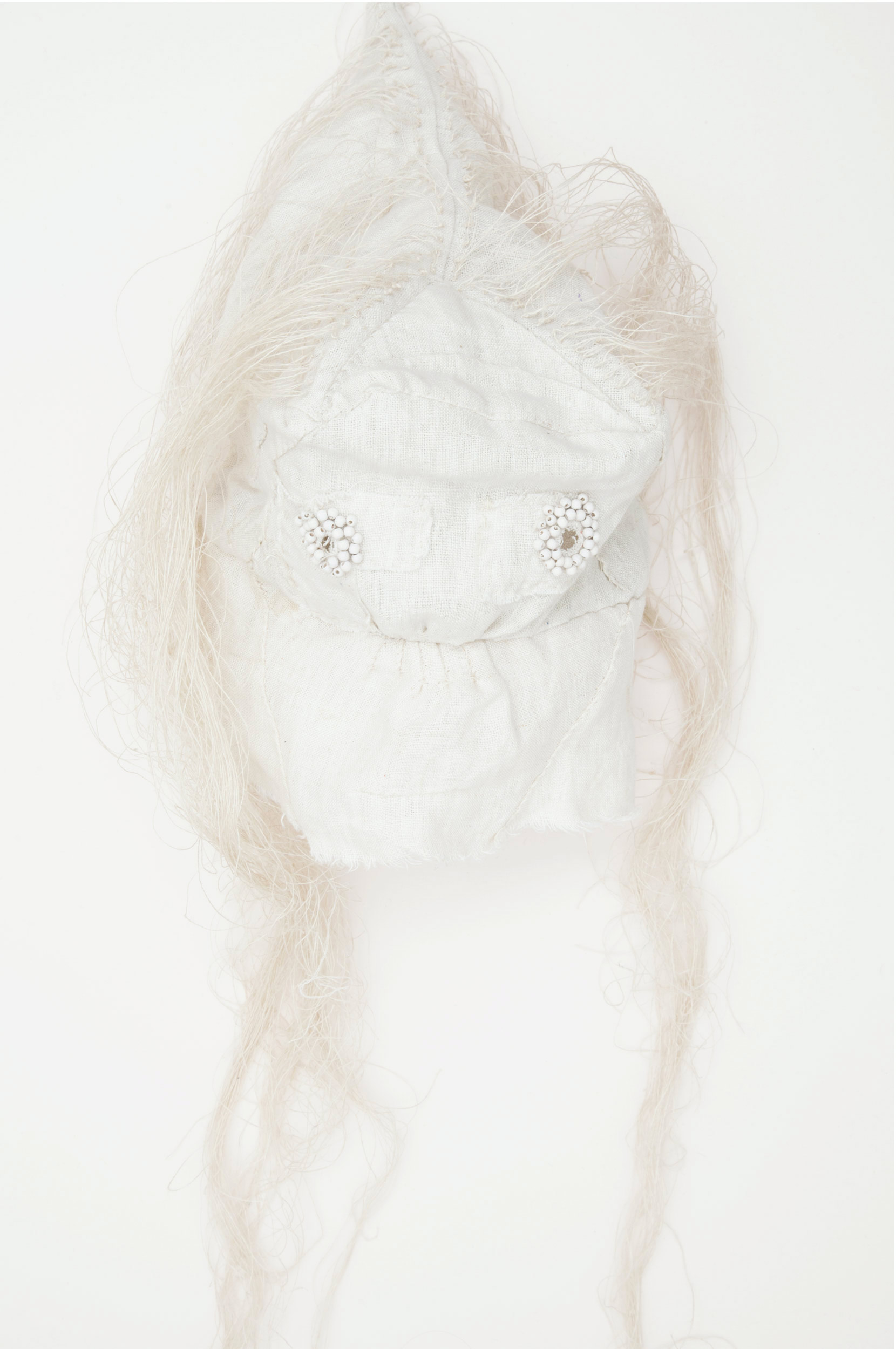 "Mask (white) / 2015 from the serie ""Apotropäen"" textiles and div. materials 25 x 25 x 70cm"