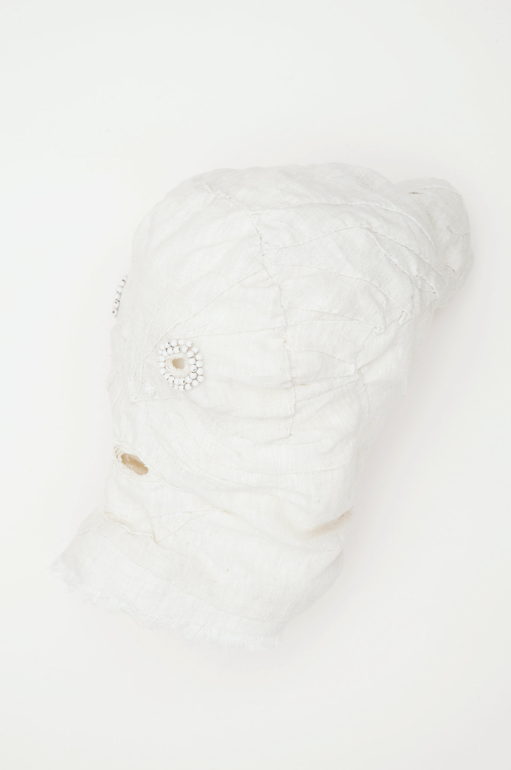 "Mask (white) / 2016 from the serie ""Apotropäen"" textiles and div. materials 25 x 25 x 30cm"