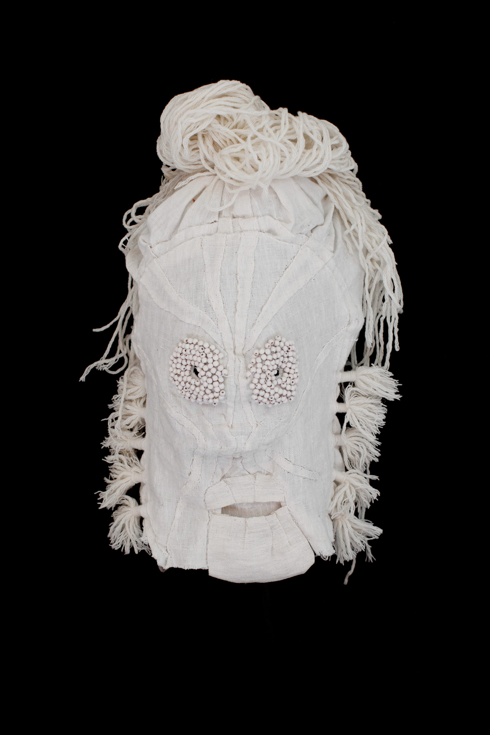 "Mask (white) / 2014 from the serie ""Apotropäen"" textiles and div. materials 25 x 25 x 30cm"
