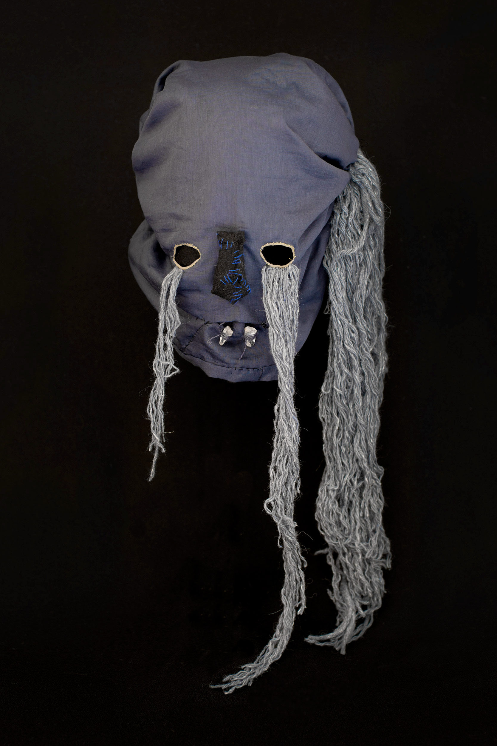 "Mask (blue) / 2014 from the serie ""Apotropäen"" textiles and div. materials 70 x 30 x 30cm"