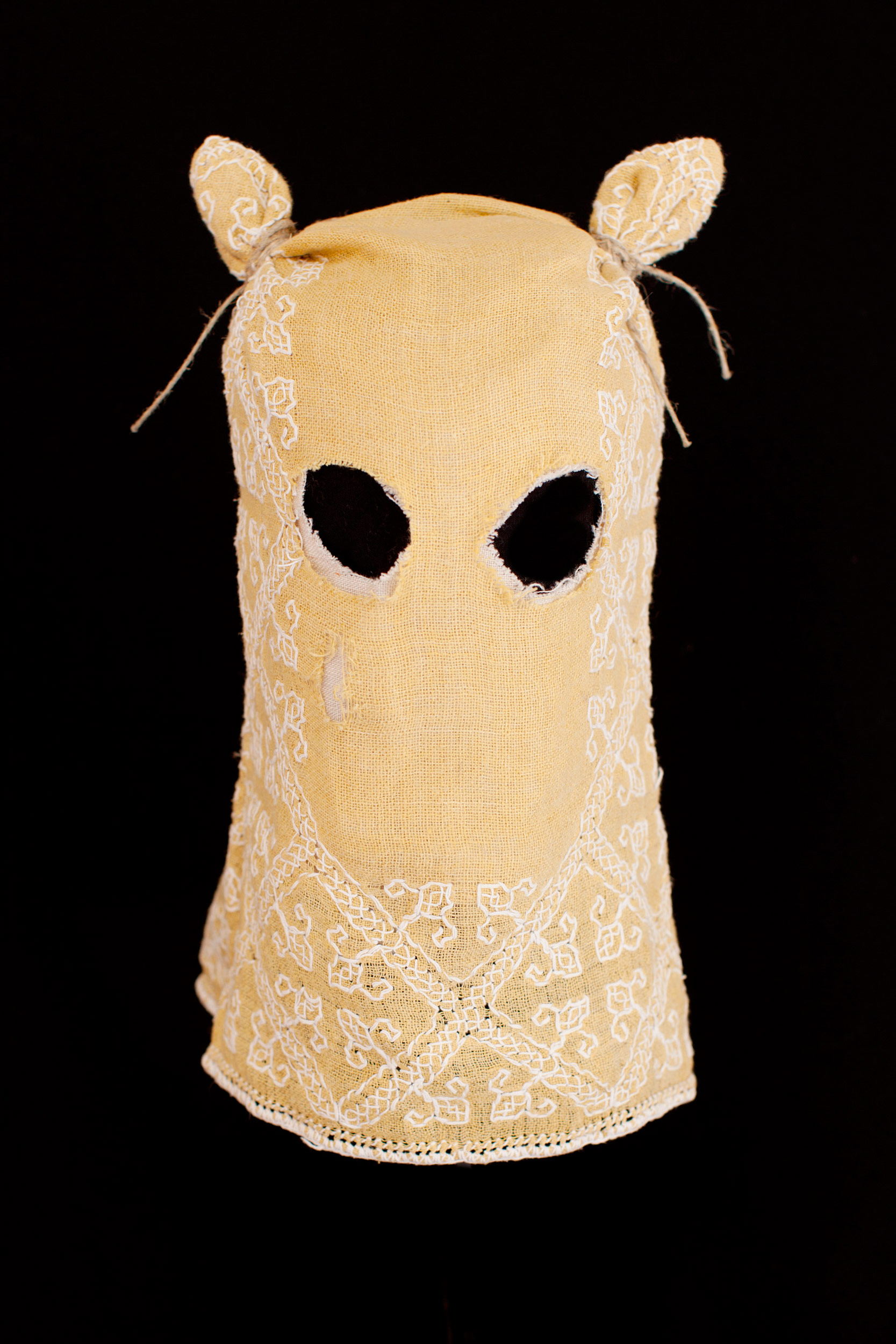 "Mask (yellow) / 2013 from the serie ""Apotropäen"" textiles and cord 25 x 25 x 30cm"