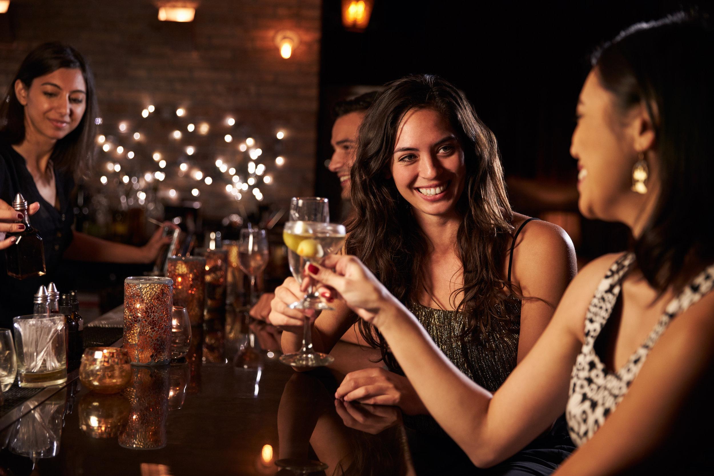 Friends sitting at a bar
