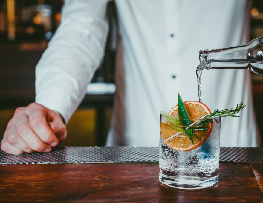 bartender pouring a cocktail.jpg