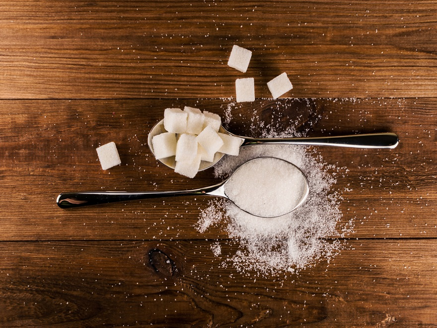 Sugar cubes on spoon