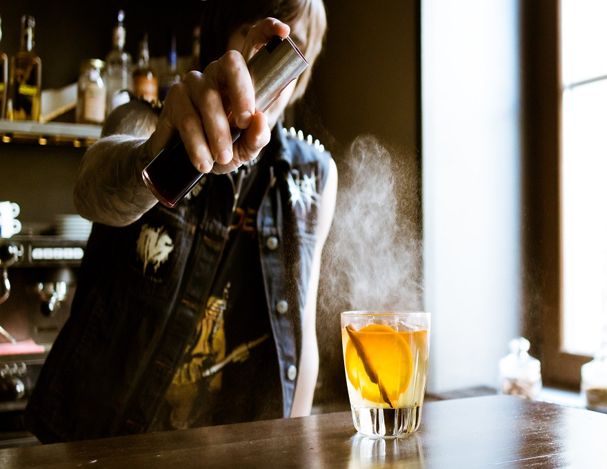 Bartender creating bespoke cocktail