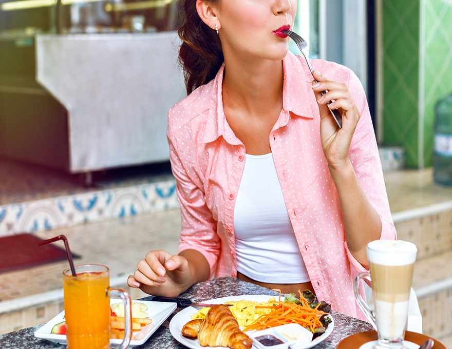 Woman eating lunch outside.jpg