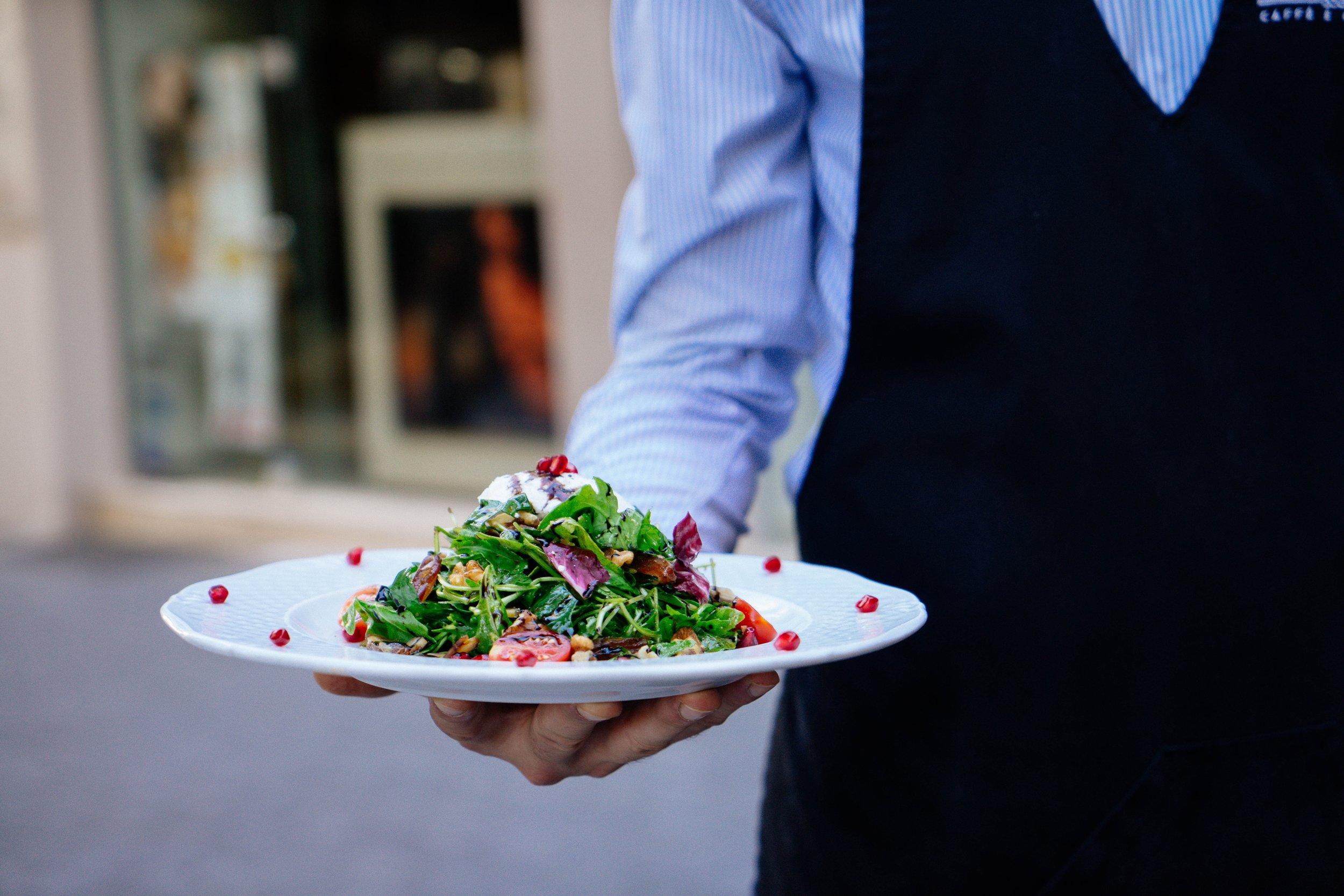 waiter serving meal outside