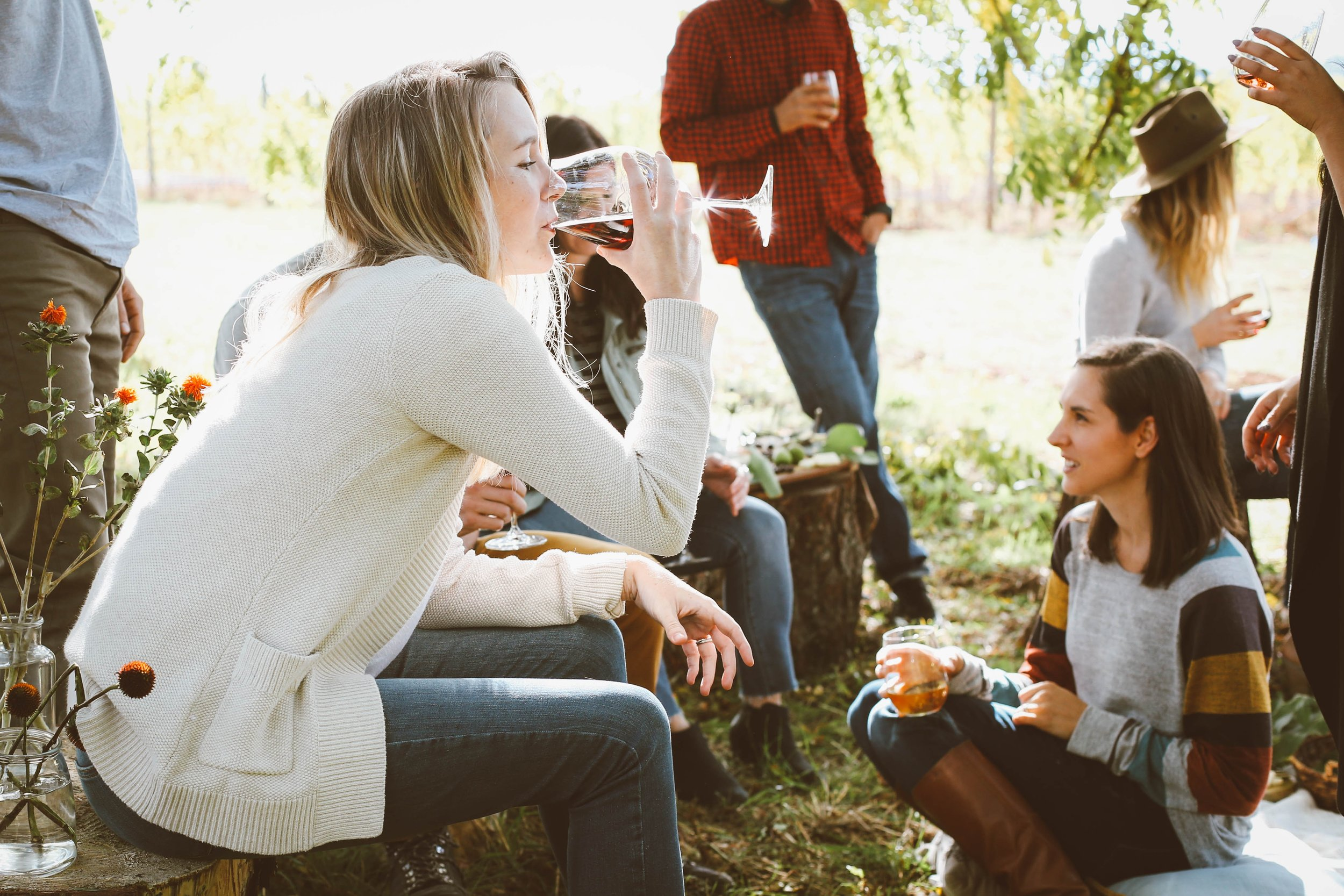 millennials drinking wine outdoors
